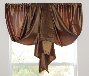 It s curtains for you imagine for Unusual ways to hang curtains